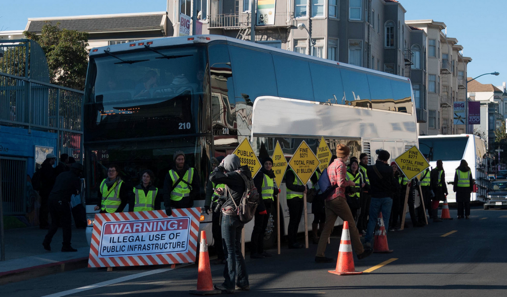 Protesters block a Google bus in San Francisco.