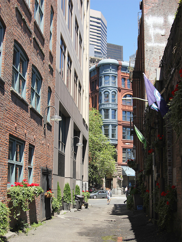 An alley in Pioneer Square, Seattle, has charming historic buildings.