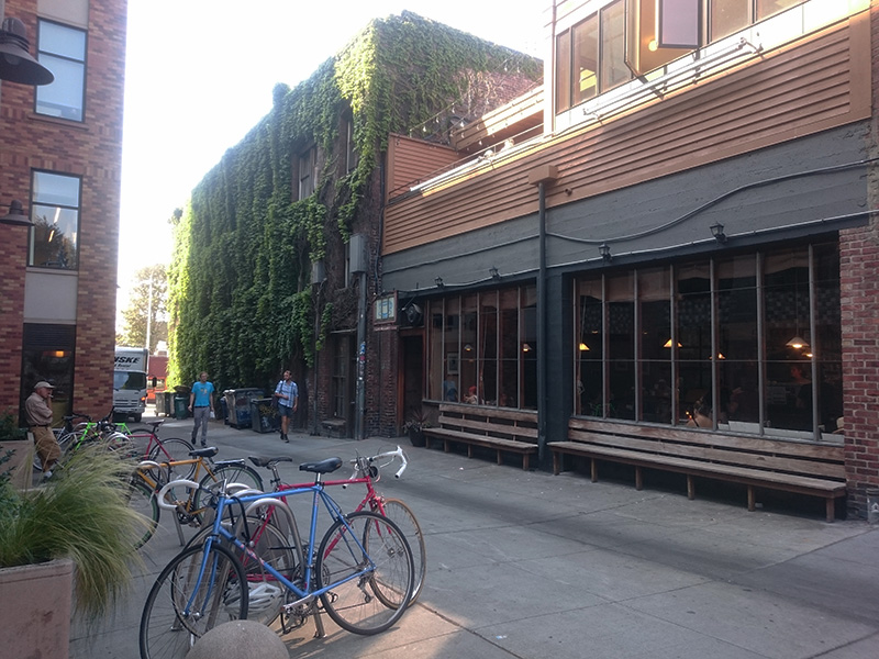 An alley in the University District, Seattle, activated with a cafe. Photo by Sarah Oberklaid.